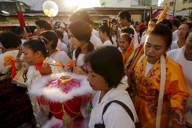 Devotees of the Chinese Jui Tui shrine walk during a procession celebrating the annual vegetarian festival in Phuket, Thailand October 19, 2015. (Photo by Jorge Silva/Reuters)