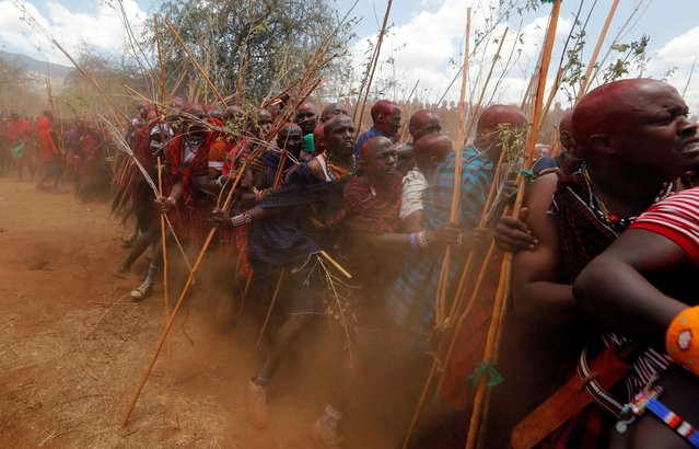 Maasai men of Matapato jostle to parade as they attend the Olng'esherr (meat-eating) passage ceremony to unite two age-sets; the older Ilpaamu and the younger Ilaitete into senior elderhood as the final rite of passage, in Maparasha hills of Kajiado, Kenya on September 23, 2020. Thousands of Maasai men clad in red and purple shawls and with their heads coated in red ochre gathered this week for a ceremony that transforms them from Moran (warriors) to Mzee (elders). (Photo by Thomas Mukoya/Reuters)