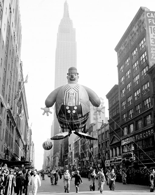 Empire State Building forms a background for this helium-filled clown floating along 34th Street in Macy Parade, 1945. (Photo by Art Whittaker/NY Daily News Archive via Getty Images)
