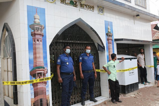 Law enforcers stand guard in front of a mosque after a gas pipeline explosion as killed 24 people in Nayaranganj, Bangladesh on September 6, 2020. (Photo by Rehman Asad/NurPhoto via Getty Images)