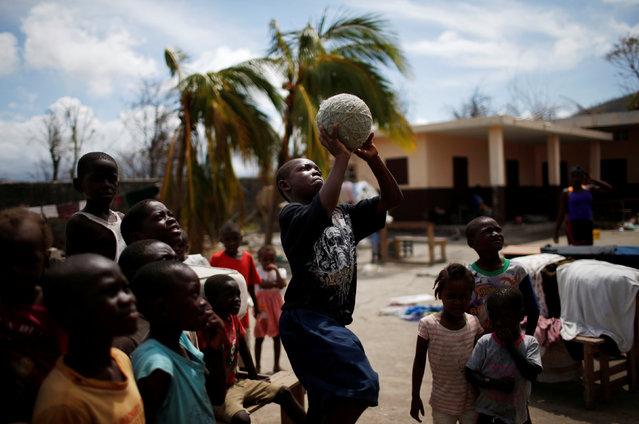 Children play at a shelter after Hurricane Matthew passes in Jeremie, Haiti, October 9, 2016. (Photo by Carlos Garcia Rawlins/Reuters)