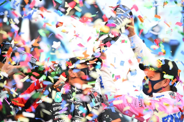 Race winner Lewis Hamilton of Great Britain and Mercedes GP celebrates winning a 7th F1 World Drivers Championship with second placed Sergio Perez of Mexico and Racing Point on the podium during the F1 Grand Prix of Turkey at Intercity Istanbul Park on November 15, 2020 in Istanbul, Turkey. (Photo by Clive Mason/Reuters)