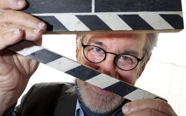 Director Steven Spielberg, president of the 66th Cannes Film Festival, plays with a clapperboard, May 14, 2013. (Photo by Eric Gaillard/Reuters)