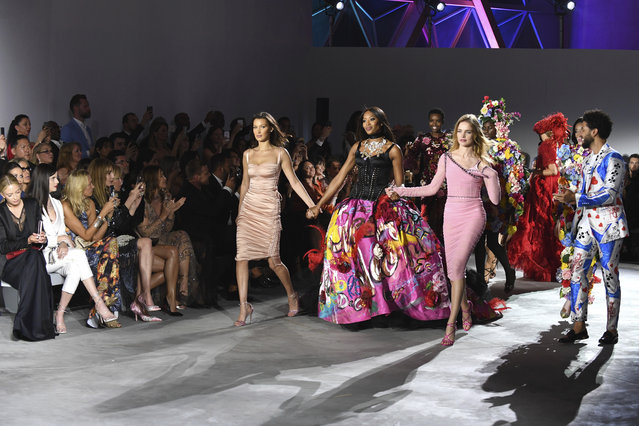 Models Bella Hadid, from centre left, Naomi Campbell and Natalia Vodianova walk the runway at the Fashion For Relief 2018 event during the 71st international film festival, Cannes, southern France, Sunday, May 13, 2018. (Photo by Arthur Mola/Invision/AP Photo)