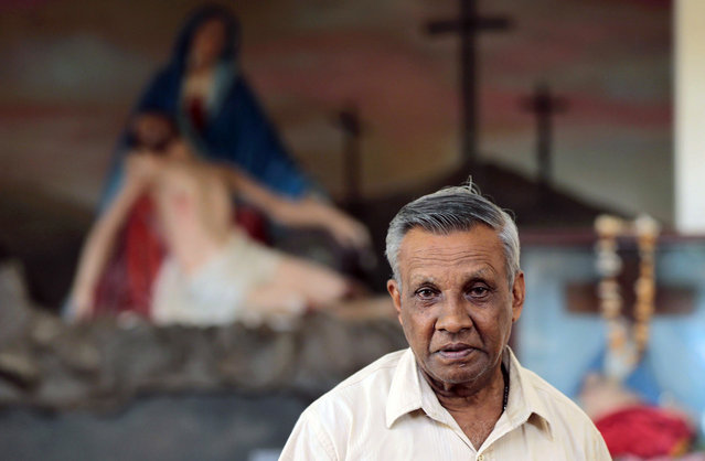 In this Wednesday, January 7, 2015 photo, a Sri Lankan Catholic devotee Maxwell Silva, 70, poses for a photograph at a church  in Colombo, Sri Lanka. Silva said the Pope's visit is a special occasion. He said Joseph Vaz after beatification had given them miracles and was qualified to be saint and that It was a privilege to be able to witness this. (Photo by Eranga Jayawardena/AP Photo)
