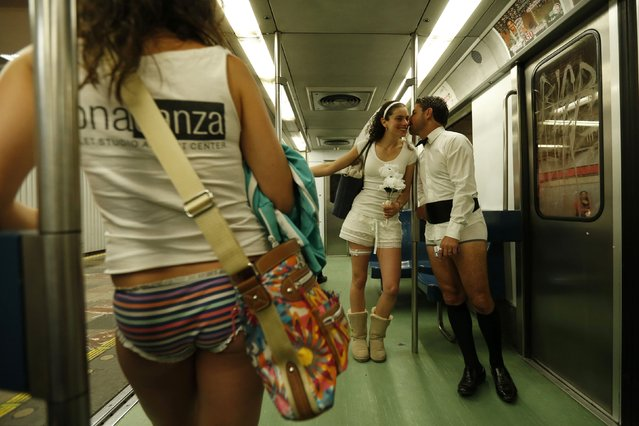 """A pair of lovers without pants ride a subway train during """"The No Pants Subway Ride"""" in Mexico City January 11, 2015. (Photo by Edgard Garrido/Reuters)"""