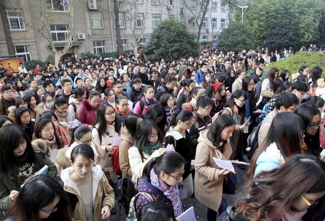 Participants Nanjing, Jiangsu province, China, November 29, 2015. More than 1.4 million people signed up for the exam to compete for over 27,000 civil servant positions this year, Xinhua News Agency reported. (Photo by Reuters/Stringer)