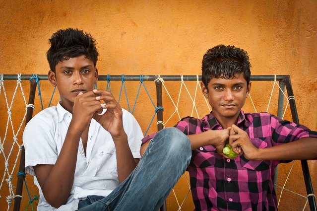 """Maldivian Teens"". These boys were relaxing on street seats in a small island town in the South Male Atoll.  (Photo and caption by Jason Wajzer/National Geographic Traveler Photo Contest)"