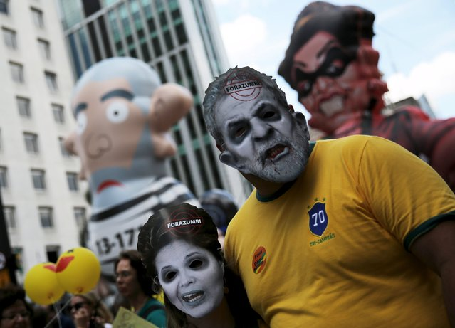 Demonstrators wear masks depicting Brazil's former president Luiz Inacio Lula da Silva (R) and Brazil's President Dilma Rousseff (L) as they take part in a protest calling for the impeachment of Rousseff at Paulista Avenue in Sao Paulo, Brazil, December 13, 2015. (Photo by Nacho Doce/Reuters)