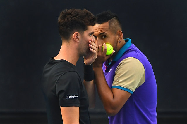 Australia's Nick Kyrgios (R) and Thanasi Kokkinakis (L) react during their men's doubles first round match against South Africa's Lloyd Harris and Austria's Julian Knowle at the Australian Open Grand Slam tennis tournament at Melbourne Park in Melbourne, Australia, 13 February 2021. (Photo by James Ross/EPA/EFE)
