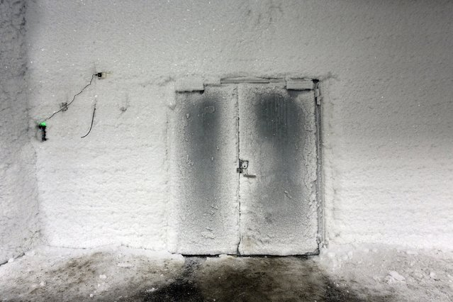 An ice covered entrance door to the international gene bank Svalbard Global Seed Vault (SGSV) near Longyearbyen on Spitsbergen, Norway, October 20, 2015. (Photo by Anna Filipova/Reuters)