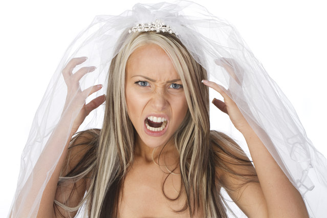 Close up of very angry and stressed out bride, isolated on white background. (Photo by CareyHope/Getty Images)