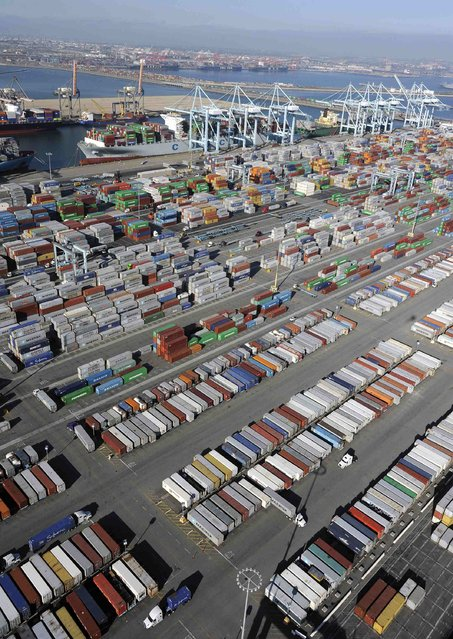 Shipping containers sit idle at the ports of Los Angeles and Long Beach, California in this aerial photo taken February 6, 2015. (Photo by Bob Riha, Jr./Reuters)