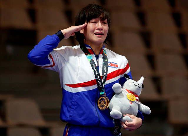North Korea' s Jong Myong Suk poses with her gold medal at the women' s freestyle 57 kg wrestling medal ceremony at the 2018 Asian Games in Jakarta on August 20, 2018. (Photo by Willy Kurniawan/Reuters)
