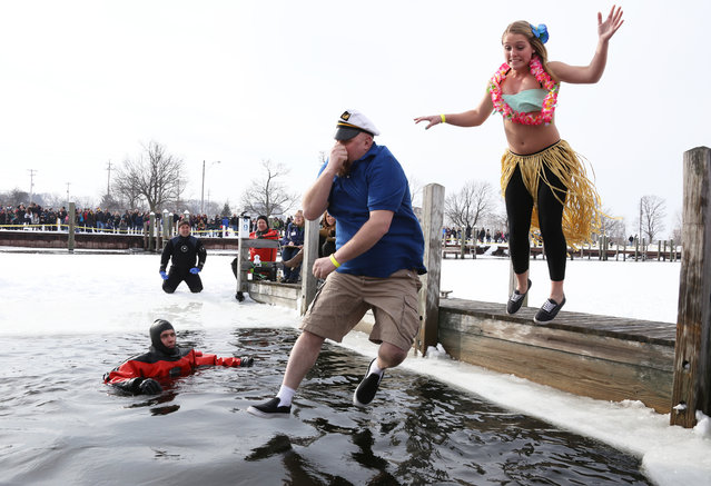 Polar Plunge participants jump into Muskegon Lake during Muskegon's Polar Plunge on Saturday, February 7, 2015. (Photo by Andraya Croft/AP Photo/The Muskegon Chronicle)