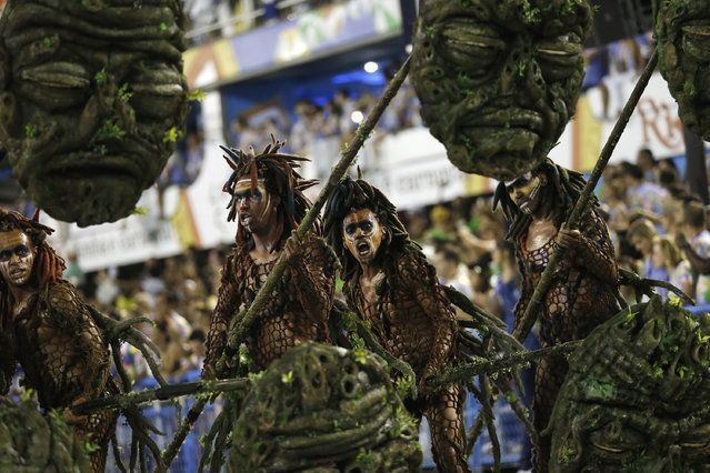 Performers from the Beija Flor samba school, parade during Carnival celebrations at the Sambadrome in Rio de Janeiro, Brazil, Tuesday, February 17, 2015. (Photo by Silvia Izquierdo/AP Photo)