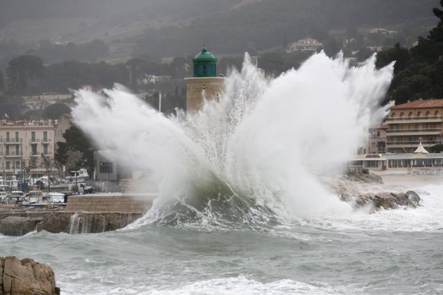 A wave crashes near the lighthouse in the port of Cassis, near Marseille, France as stormy weather with high winds hits part of the French Mediterranean coast January 11, 2016. (Photo by Jean-Paul Pelissier/Reuters)