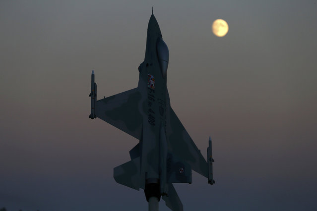 A model of a F-16 aircraft, marking the 4,400th F-16 produced and delivered for Poland, is seen at dusk at Lask air base October 6, 2014. NATO will stand by member state Turkey if it comes under attack as a result of the fighting in neighboring Syria, alliance Secretary-General Jens Stoltenberg said on Monday. (Photo by Kacper Pempel/Reuters)