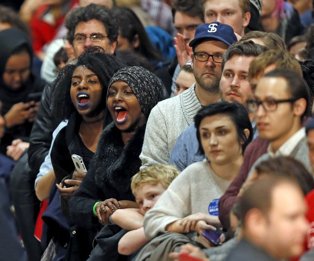 Protesters chant as Democratic presidential hopeful Bernie Sanders speaks during a campaign rally in St. Paul, Minnesota, January 26, 2016. (Photo by Eric Miller/Reuters)