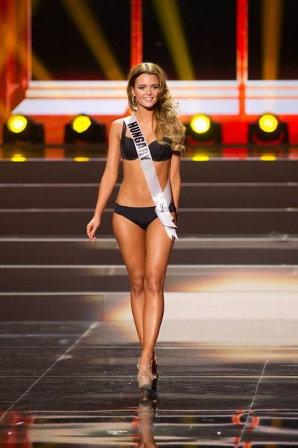 This photo provided by the Miss Universe Organization shows Rebeka Karpati, Miss Hungary 2013, competes in the swimsuit competition during the Preliminary Competition at Crocus City Hall, Moscow, on November 5, 2013. (Photo by Darren Decker/AFP Photo)