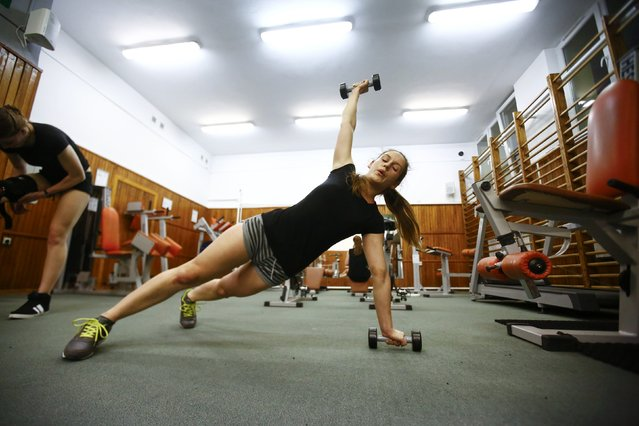 Urszula Sidoruk, 19, from the paramilitary group SJS Strzelec (Shooters Association), trains her workout at a gym in Siedlce, eastern Poland March 18, 2014. (Photo by Kacper Pempel/Reuters)