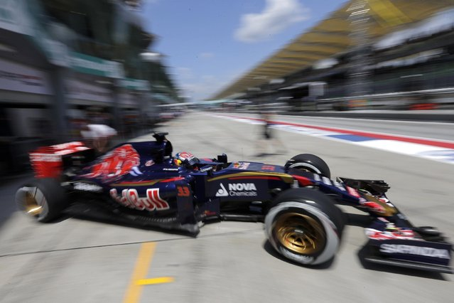 Toro Rosso driver Max Verstappen of the Netherlands steers his car out of his team's garage during the second practice session for the Malaysian Formula One Grand Prix at Sepang International Circuit in Sepang, Malaysia Friday, March 27, 2015. (Photo by Andy Wong/AP Photo)