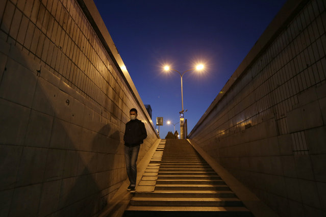 A pedestrian walks through an underground passage on the eve of the Chinese Lunar New Year, in Beijing, China, February 7, 2016. (Photo by Jason Lee/Reuters)