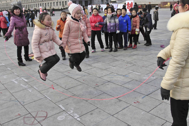 North Korean students skip rope as they gather at Kim Il Sung Square for Lunar New Year in Pyongyang, North Korea, Monday, February 8, 2016. (Photo by Jon Chol Jin/AP Photo)