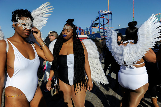 Women dressed as angels prepare to participate in the annual Polar Bear Plunge in Coney Island in the Brooklyn Borough of New York City, U.S. January 1, 2017. (Photo by Stephanie Keith/Reuters)