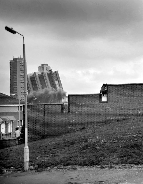 Youngsters look on as the world-famous Red Road flats are finally demolished. (Photo by Brian Anderson)