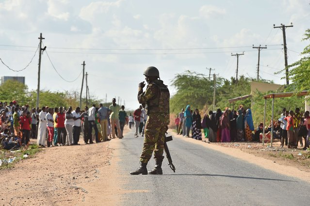 A Kenya Defence Forces soldier stands guard before they ended a siege by gunmen in the university campus of the northeastern town of Garissa on April 2, 2015. (Photo by Carl De Souza/AFP Photo)
