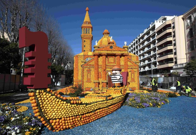 "Workers put the final touch to a replica of a gondola and a Venetian palace made with lemons and oranges which shows a scene of the movie ""Morte a Venezia"" (Death in Venice) during the Lemon festival in Menton, southern France, February 10, 2016. Some 140 metric tons of lemons and oranges are used to make displays during the 83rd festival, which is themed ""Cinecitta"", and runs from February 13 through March 2. (Photo by Eric Gaillard/Reuters)"