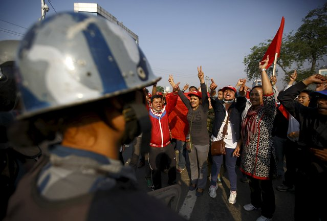 Protesters shout anti government slogans during a nationwide strike, organised by the opposition alliance led by the Unified Communist Party of Nepal (Maoist) to demand the new constitution be drafted with the consensus of all political parties, in Kathmandu April 07, 2015. (Photo by Navesh Chitrakar/Reuters)