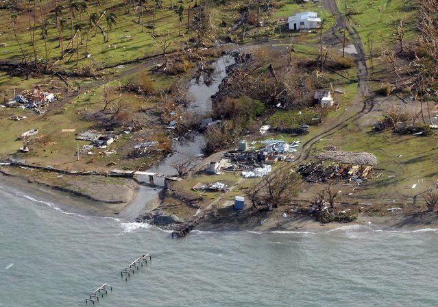 A remote Fijian village is photographed from the air during a surveillance flight conducted by the New Zealand Defence Force following Cyclone Winston on February 21, 2016. (Photo by Reuters/NZ Defence Force)