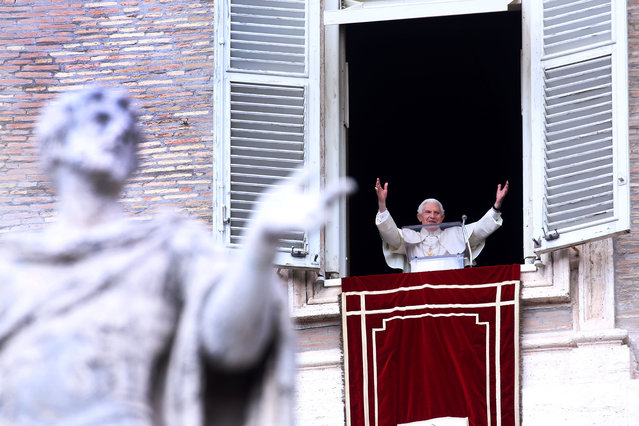 Pope Benedict XVI delivers his last Angelus Blessing from the window of his private apartment to thousands of pilgrims gathered in Saint Peter's Square on February 24, 2013 in Vatican City, Vatican. (Photo by Franco Origlia/Getty Images)
