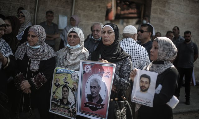 Palestinians gather to protest against Israeli policy of administrative detention in front of building of International Committee of the Red Cross (ICRC) in Gaza City, Gaza on August 09, 2021. (Photo by Ali Jadallah/Anadolu Agency via Getty Images)