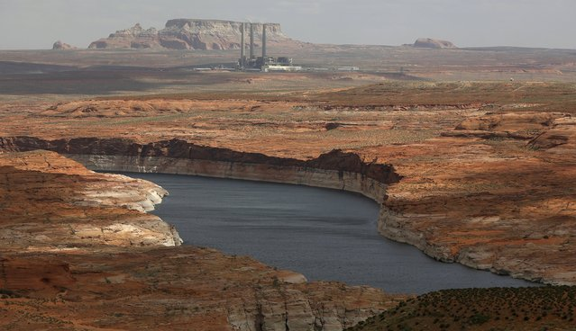 The Navajo Generating Station, a coal-fired powerplant, can be seen near the Colorado River fed Lake Powell outside Page, Arizona, April, 14, 2015. (Photo by Jim Urquhart/Reuters)