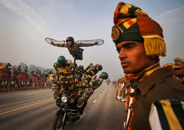 Soldiers perform on a moving motorcycle during Republic Day Parade rehearsals in New Delhi, India, on January 13, 2014. The day is celebrated on Jan. 26 every year. (Photo by Saurabh Das/Associated Press)