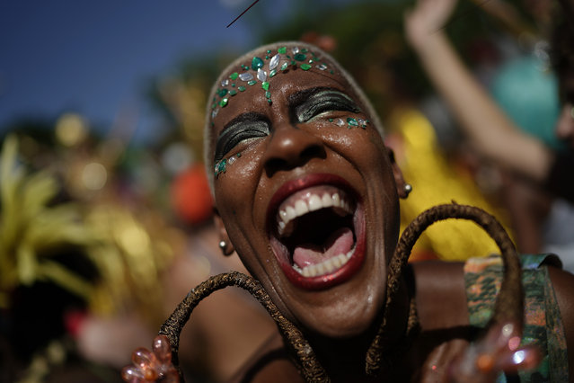 "A reveler in costume laughs during the ""Cordao do Boitata"" street party in Rio de Janeiro, Brazil, Sunday, February 24, 2019, one of the many parades before the official start of Carnival on March 1. (Photo by Leo Correa/AP Photo)"