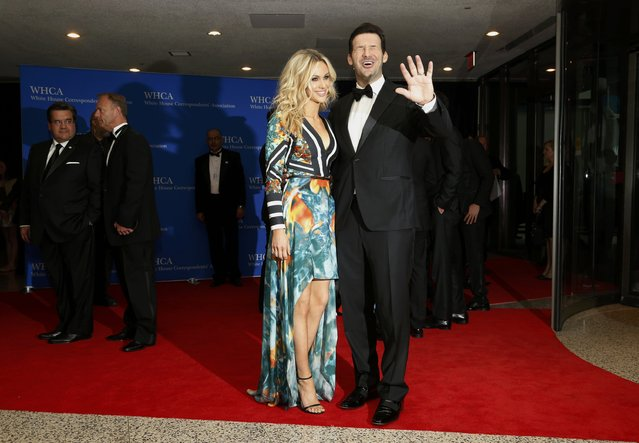 Dallas Cowboys quarterback Tony Romo and his wife, Candice, arrive for the annual White House Correspondents' Association dinner in Washington April 25, 2015. (Photo by Jonathan Ernst/Reuters)