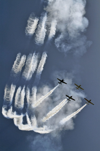 Aircrafts of British Aerobatics Champions perform during rehearsals on the eve of the Gujarat Aero Conclave 2015 in Ahmadabad, India, Tuesday, March 31, 2015. (Photo by Ajit Solanki/AP Photo)