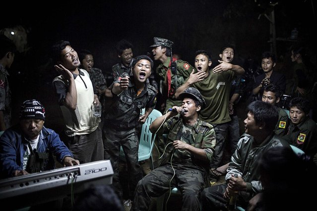 1st prize in the Daily Life Single category. Julius Schrank, Germany, for De Volkskrant. The photo shows Kachin Independence Army fighters drinking and celebrating at a funeral of one of their commanders who died the day before, in Burma, March 15, 2013. (Photo by Julius Schrank/World Press Photo)