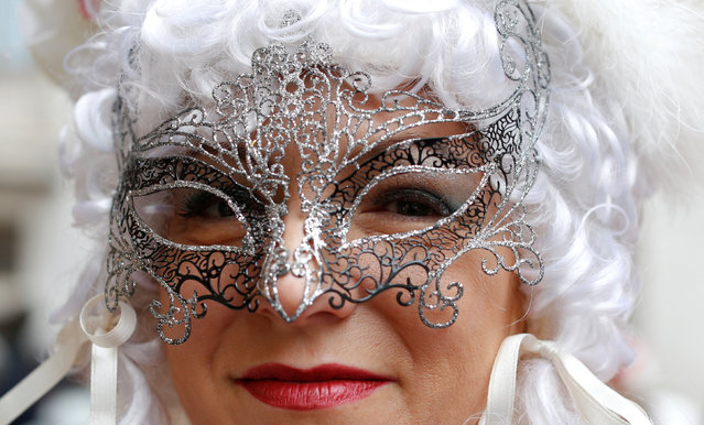 A masked reveller poses during the Venice Carnival in Venice, Italy February 11, 2017. (Photo by Tony Gentile/Reuters)