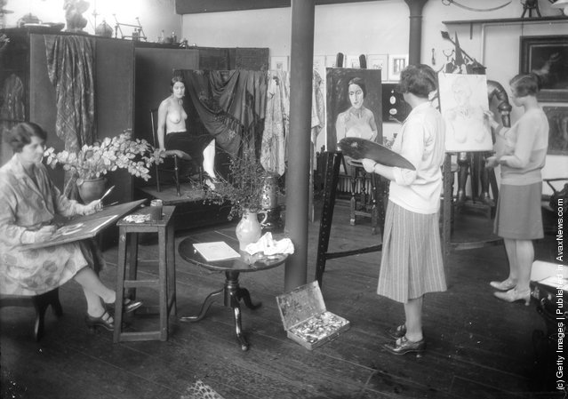 November 1927:  Students at the Heatherley School of Art in Baker Street, London, painting a nude model in the portrait studio
