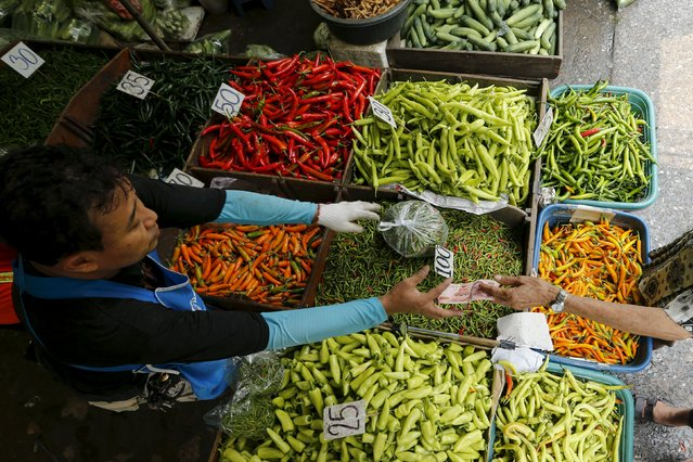 A vendor sells chili peppers at his stall at a market in Bangkok, Thailand March 31, 2016. (Photo by Jorge Silva/Reuters)
