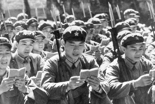 1970: Chinese Red Guards reading from the little red book of Thoughts of Chairman Mao before starting their day