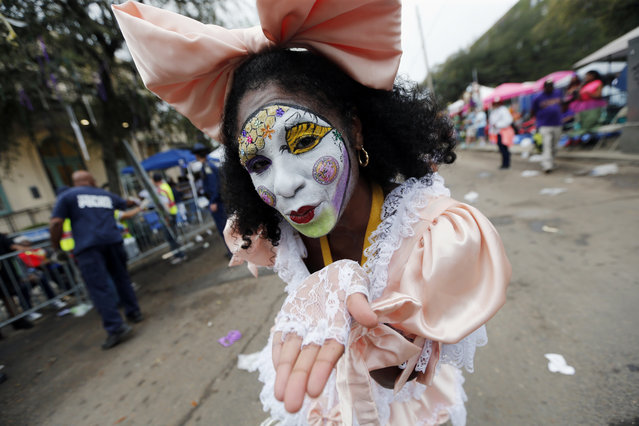A member of the New Orleans Baby Doll Ladies walks down St. Charles Avenue ahead of the Zulu Parade during Mardi Gras in New Orleans, Tuesday, February 28, 2017. (Photo by Gerald Herbert/AP Photo)
