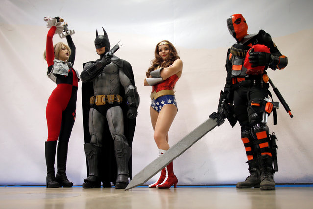 Visitors dressed in superhero costumes attend the Paris Comics Expo at the Parc Floral in Paris, France, April 15, 2016. (Photo by Charles Platiau/Reuters)