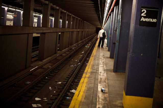 A man waits for the New York subway prior to the arrival of Hurricane Sandy on October 28, 2012 in New York, United States. New York plans on shutting down the entire public transmit system starting at 7PM, Sunday night. Sandy, which has already claimed over 50 lives in the Caribbean, is predicted to bring heavy winds and floodwaters as the mid-atlantic region prepares for the damage. (Photo by Andrew Burton/Getty Images)