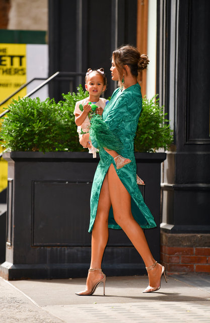 Chrissy Teigen and daughter Luna Stephens seen on the streets of Manhattan on June 24, 2019 in New York City. (Photo by James Devaney/GC Images)